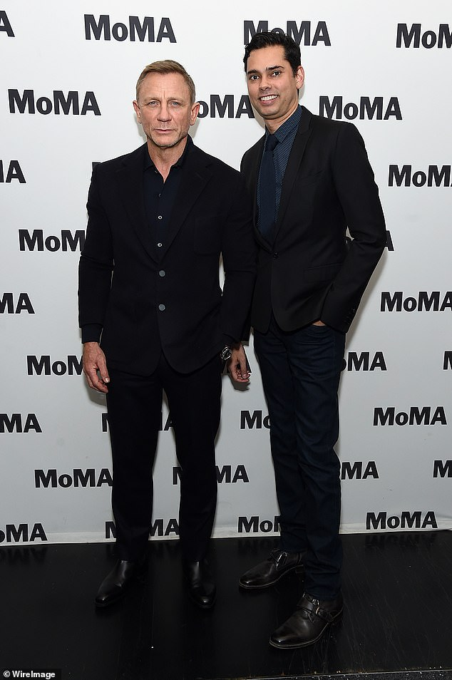 Strict schedule: Leading actor Daniel attended the MoMA's Film Series, In Character: Daniel Craig, at New York's Museum of Modern Art on Tuesday (pictured with chief curator Raj Roy)
