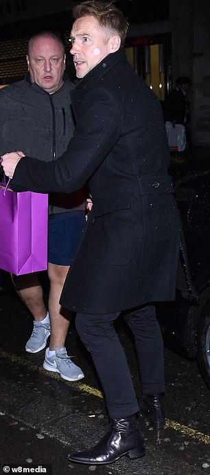 Helpful: Ronan carried around gift bags