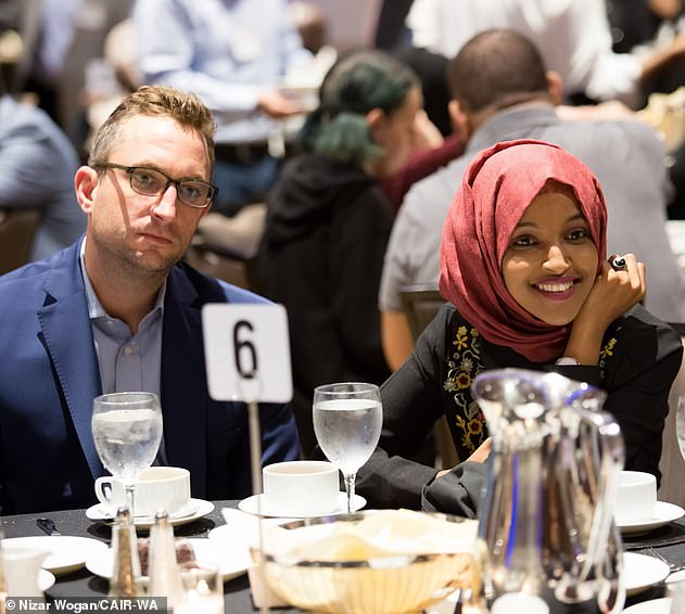 DailyMail.com broke the news last year that Omar was having an affair with then- married Mynett, whose firm E. Street Group she continues to pay for consultancy work. The two are pictured together on May 26 at a Council on American-Islamic Relations (CAIR) event - a month after he told his wife he was leaving her