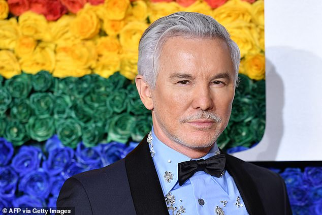 'We request all cast and crew stay at home today': Baz Luhrmann has temporarily halted production of his upcoming Elvis Presley biopic after star Hanks caught coronavirus