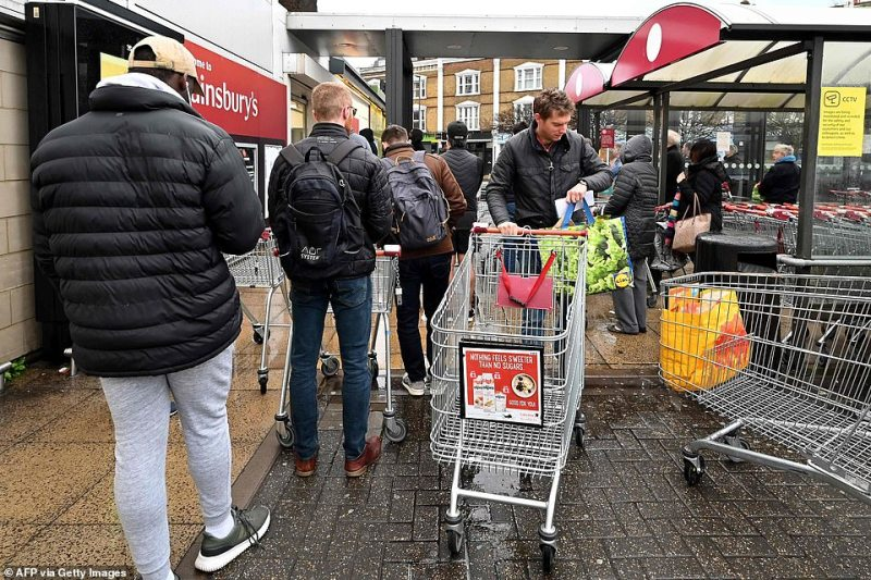 People are rushing to superstores (pictured, Sainsbury's in London) to grab goods before the coronavirus peaks