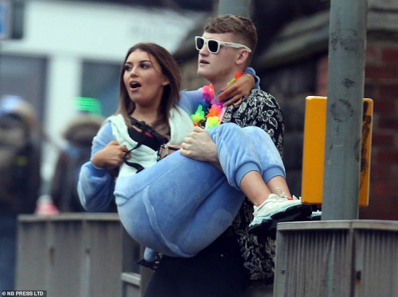 A man carries a woman during the lengthy Otley run which usually visits sixteen individual venues