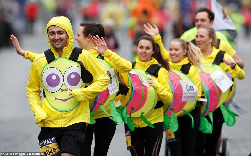 Runners in fancy dress during the race as the marathon goes ahead despite the number of coronavirus cases growing around the world