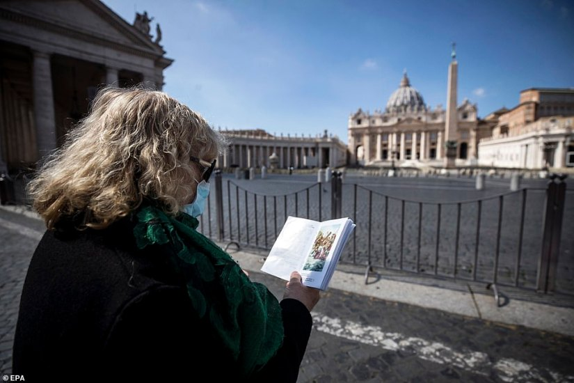 St. Peter's Square was closed to worshipers, but a faithful today wore a mask and prayed outside during the blessing of Francis