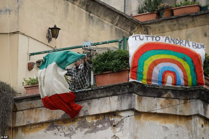 On this balcony in the Gabriella district of Rome, banners with