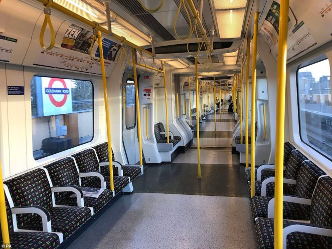 A sparsely-filled carriage on an Underground train in west London this morning, after workers were advised not to come into their offices