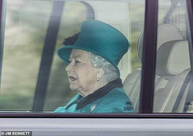 The Queen (pictured in Windsor on Sunday) returned to Buckingham Palace today to continue her duties despite the outbreak of the corona virus