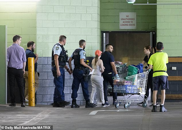 Prof Bowtell says there should be a police presence at supermarkets. Above, officers at Westfield Parramatta following an alleged stoush over toilet paper
