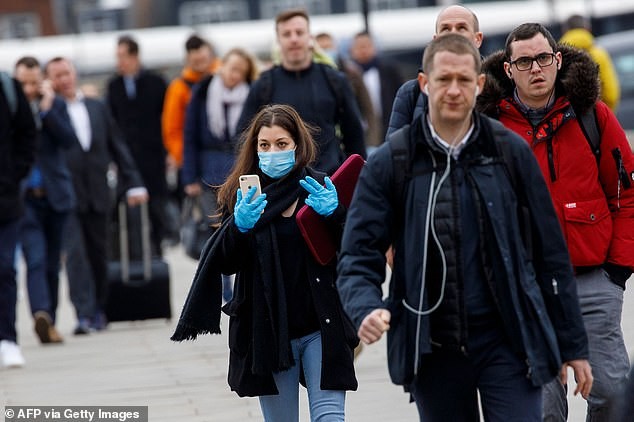A commuter wears a mask and gloves whilst walking across London Bridge into the City of London during the morning rush hour. Facebook is already working on providing anonymized and aggregated data on people's movements for researchers and nonprofits