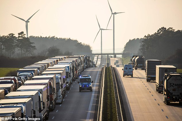 A police vehicle patrol the A12 motorway as trucks are stuck in a traffic jam stretching more than 65 km towards Berlin from the German-Polish border near the eastern German town of Frankfurt (Oder) due to travel restrictions to counteract the spread of COVID-19 on Wednesday