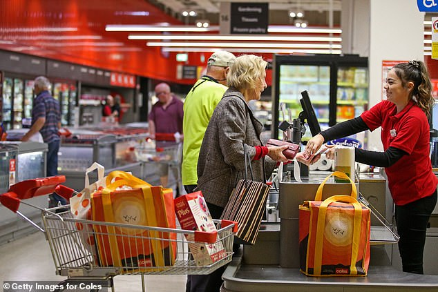 Coles and Woolworths have implemented an shopping hour dedicated to elderly and disabled shoppers to give them a chance to stock up on supplies. Pictured is the first Coles Community hour at Southland, Melbourne, on March 18