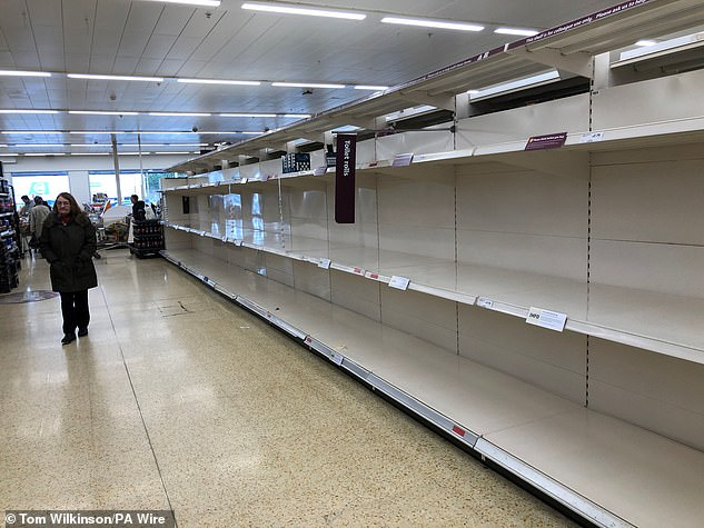 Empty shelves where toilet roll is usually stocked in a Sainsbury's supermarket at the Arnison Centre in Durham, the day after Prime Minister Boris Johnson called on people to stay away from pubs, clubs and theatres, work from home if possible and avoid all non-essential contacts and travel