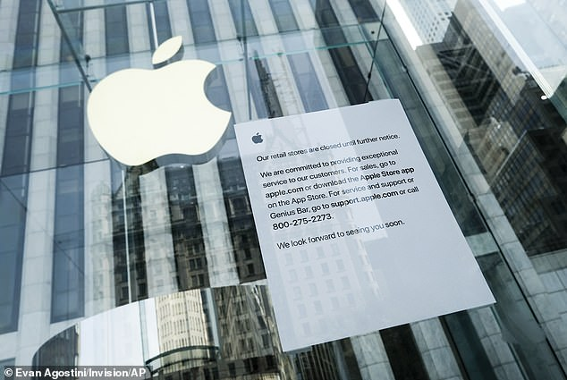 On Tuesday, Apple announced the closure all of its 272 stores in the US over fears of the coronavirus 'until further notice. Pictured is a closure sign hanging in a location on Fifth Avenue in New York City