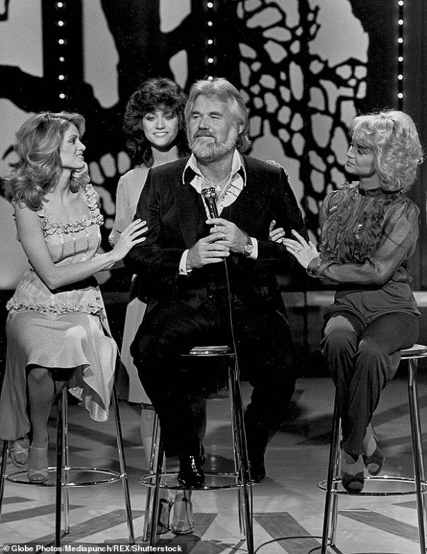 Legend:Rogers - pictured left to right: Irlene Mandrell Louise Mandrell and Barbara Mandrell in 1980 - with thrived as his career began in 1957 before he retired from touring in 2017 at age 79