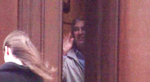 Prince Andrew pictured waving to a brunette from Jeffrey Epstein's Manhattan home in 2010