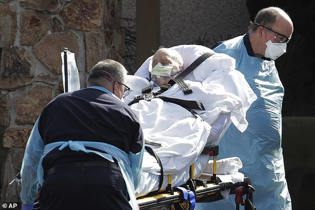 Officials from the DOJ state that there are currently no COVID-19 vaccines nor is the WHO distributing any vaccines. Pictured: A person is loaded into an ambulance the Life Care Center in Kirkland, Washington, March 12
