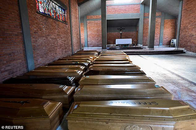 Coffins of people who have died from coronavirus disease (COVID-19) are seen in the church of the Serravalle Scrivia in Alessandria, Italy