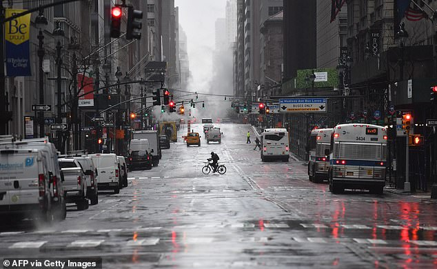 Only a few bicycles and cars were spotted on Fifth Avenue in Manhattan Monday morning. Both Mayor Bill de Blasio and Governor Cuomo are considering shutting streets off to car traffic to allow for people walking to get essentials to spread out further