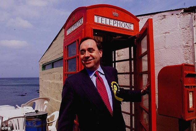 Salmond joined the SNP while at the University of St Andrews studying economics and history. On graduation he took up a civil service post as an assistant economist. He is pictured above visiting Pennan, Aberdeenshire in 1999