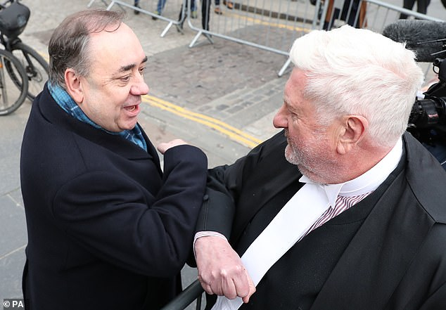 Alex Salmond (left) elbow bumps Gordon Jackson QC as he leaves the High Court in Edinburgh