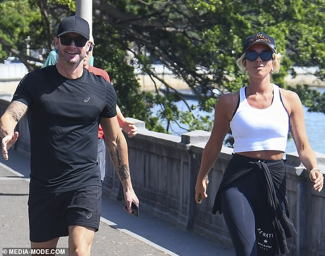 Happy chappy! The retired Australian cricket captain, 38, flashed a million-dollar smile as he soaked up the sun with the glamorous activewear mogul