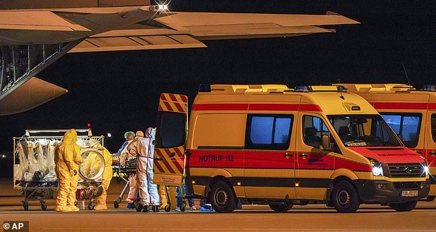 Germany announced a 21% increase in overnight coronavirus cases to over 27,000 with an increase in deaths to 114 - but still has one of the lowest mortality rates in the world (pictured, patients at Leipzig airport )