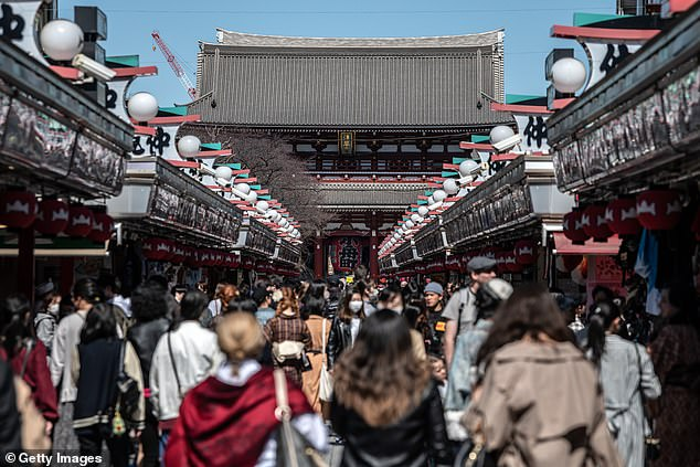 Anti-Japan sentiment has been deep-rooted among Chinese nationalists as territorial disputes and World War II grievances have marred the Japan-China relationship for decades.Tourists are pictured visiting the area around Sensoji Temple in Tokyo on March 11