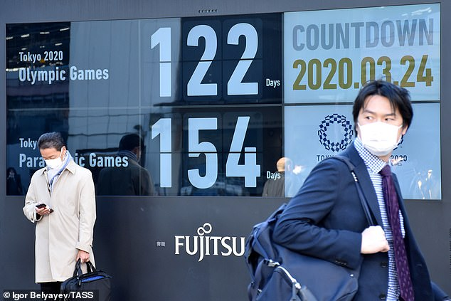 Chinese nationalists use phrases like 'little Japan' to dismissively refer to the island country and its citizens. Residents are pictured in Tokyo as Japan counts down till the 2020 Olympics