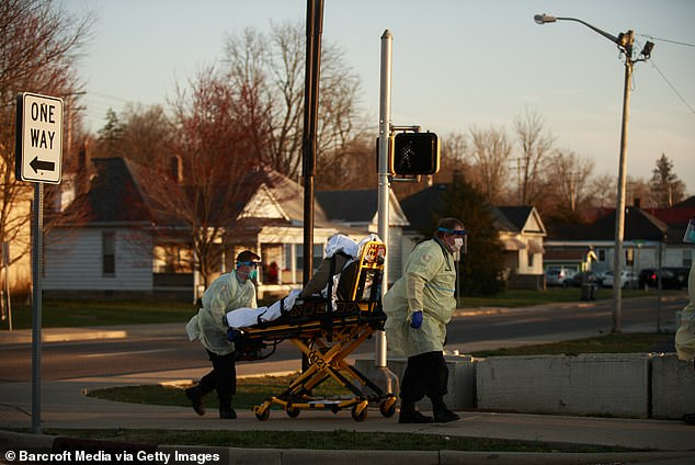 The relations even intensified during the coronavirus pandemic as the two countries keep firing at each other with accusations. Medics are seen escorting a patient in Bloomington