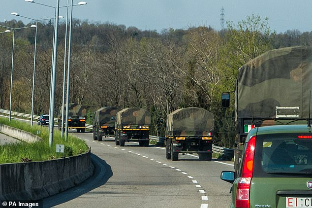 Army trucks transport coffins from a depot in Ponte San Pietro, with the death toll in Italy accumulating - although in the last two days it has slowed down