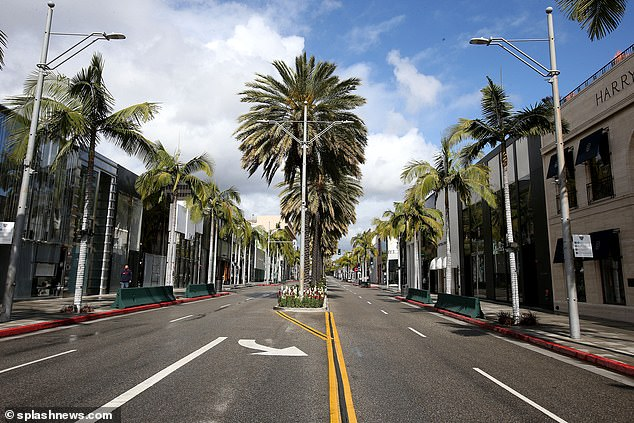 Rodeo Drive in Beverly Hills is deserted as shops close and people self-isolate in efforts to stem the spread of the coronavirus