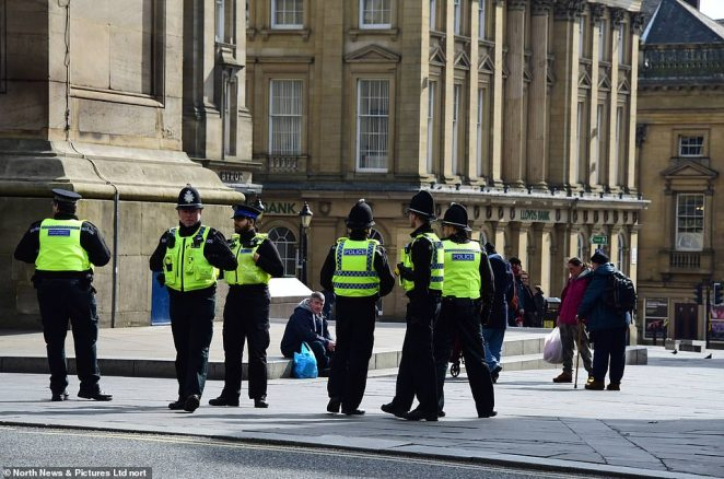 Police gather at Newcastle's Monument, moving on people who gather in a bid keep the population social distancing in order to stop the coronavirus spreading on Monday