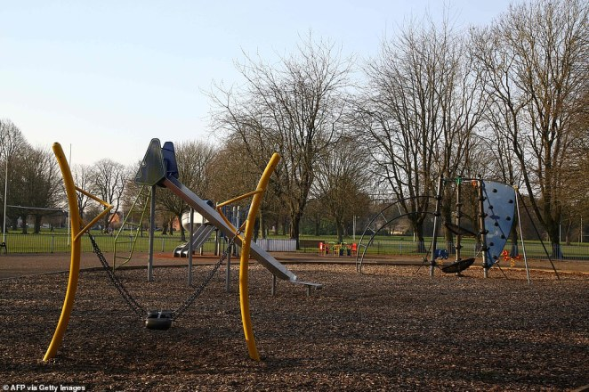 An empty children's play area on Llandaff Fields in Cardiff, South Wales, this morning as the country goes into lockdown