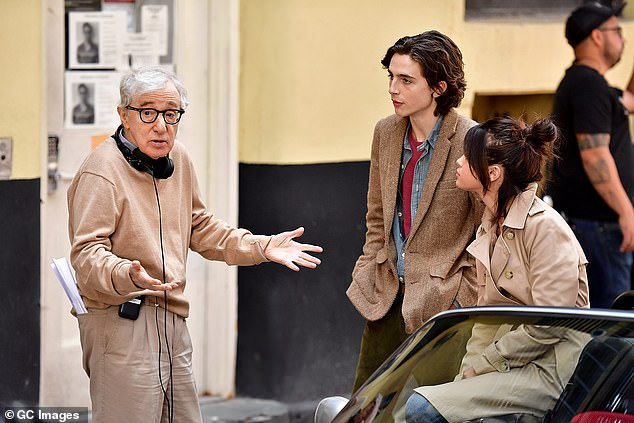 Amazon backed out of a $73 million deal to release Allen's next four films, he was cut out of a PBS poetry documentary and his latest film, A Rainy Day in New York, was not released in the US because nobody would distribute it. Pictured: Allen with Selena Gomez and Timothe Chalamet on the set of Allen's movie in September 2017