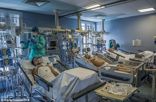Heading here: Dr. Spencer described a hectic scene not dissimilar to those being pictured in Italy (pictured: hospital in Cremona, Italy on March 23)