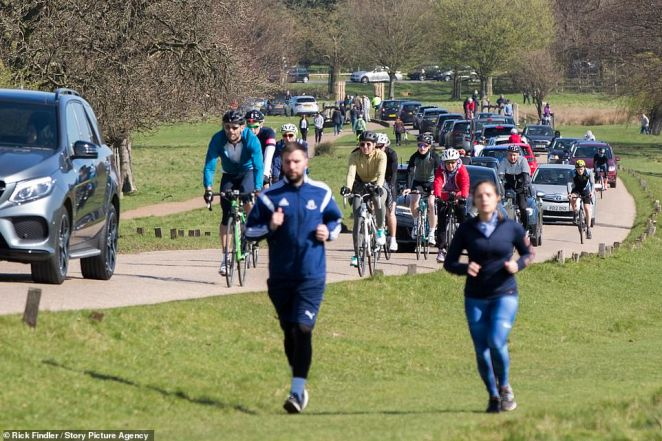 Yesterday: Scores of joggers and cyclists pack into a sun-kissed Richmond Park before Mr Johnson announced tough new measures to keep people indoors