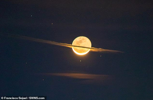 This extraordinary image captured a new perspective of the moon, making it appear as its distant neighbor Saturn