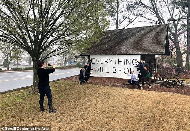 Residents of Dunwoody, Georgia are hoping to raise spirits amid the coronavirus crisis by placing optimistic signs in shop windows and front yards across their small city. The original 2009 mural by artist Jason Kofke is pictured