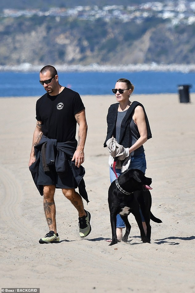 Fresh air:House of Cards star Robin Wright was spotted out with her husband Clement Giraudet in Santa Monica taking their dog for a walk on the beach in Santa Monica on Tuesday