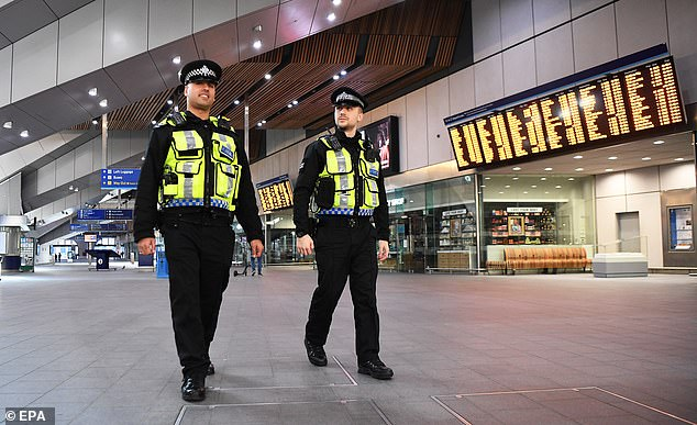 Police patrol London Bridge Station today after Boris Johnson announced that Britons can only leave their homes for essential reasons or may be fined