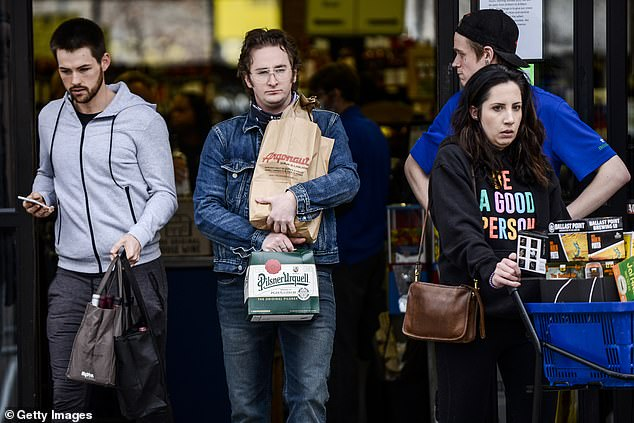 Never thirsty again!People brave crowds to buy supplies at Argonaut Wine and Liquor on Monday in Denver