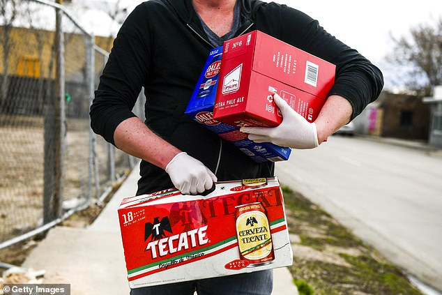 Gotta stock up!Joe Snooks stocks up on beer and liquor on Tuesday in Denver