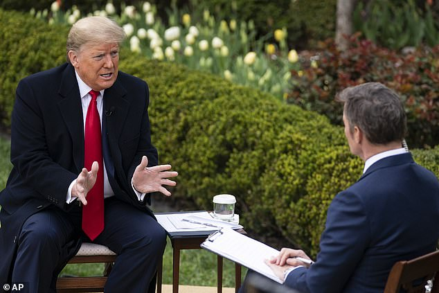 President Trump (left) told Bill Hemmer (right) during a Fox News Channel program in the Rose Garden Tuesday that he wanted to see the U.S. back in business by Easter Sunday
