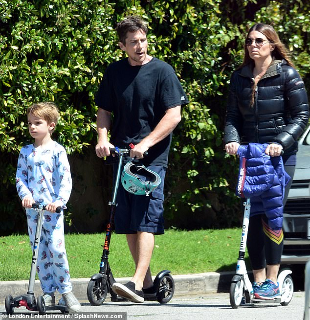 Family ride: Bale, 45, joined his wife Sibi Blazic, 49, and their son Joseph, five for a scooter ride around their Brentwood neighborhood on Tuesday
