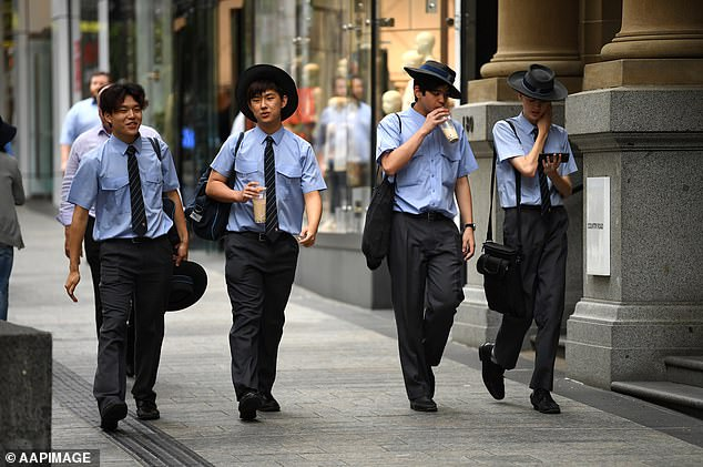A group of school students at Queen Street mall in central Brisbane on Tuesday after the Queensland premier advised schools to remain open