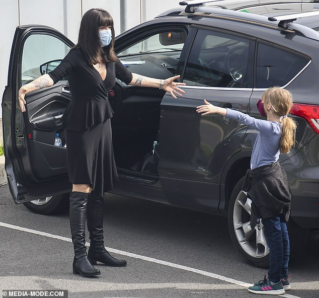 No touching! The emotional reunion took place in the airport carpark, and saw Canadian-born Tara greet her loved ones by waving her arms around in the air