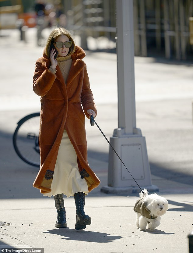 Lockdown look: The 34-year-old The City star wore a burnt orange teddy coat, a tan sweater and an off-white skirt for the chic stroll through the desolate city