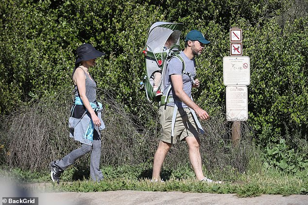 Husband's look:Her husband was wearing a grey t-shirt and khaki shorts with a teal baseball cap and sneakers