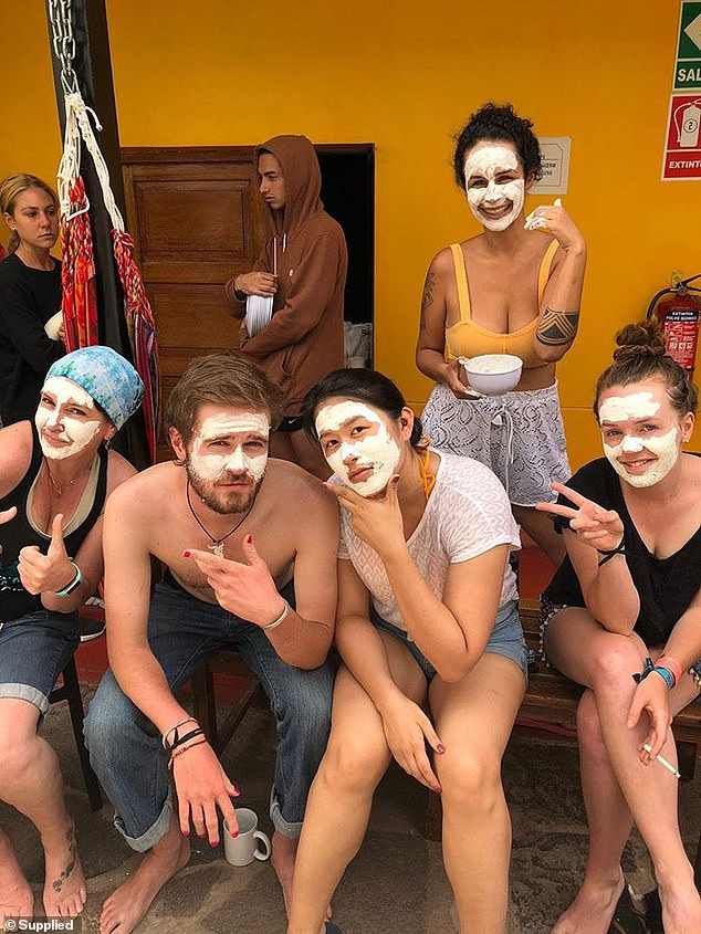 'We're trying to keep our spirits up and keep each other entertained, but we're all a bit nervous about what's going on,' Ms Carter said of the group trapped in the hostel