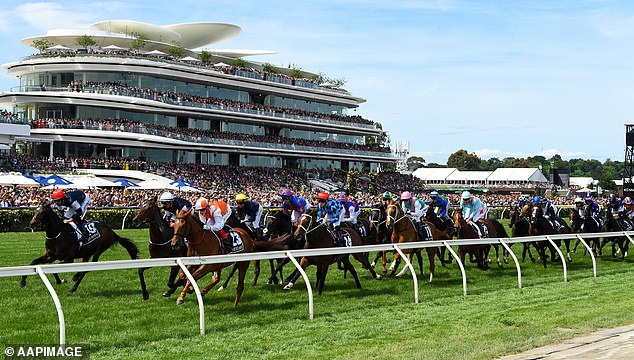 Horse racing in Victoria has been suspended after a racing identity caught the same flight as someone with coronavirus. Pictured: the Melbourne Cup at Flemington Racecourse in 2019